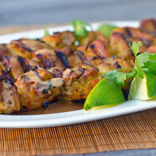 Grilled Thai Curry Chicken Skewers with Coconut-Peanut Sauce.