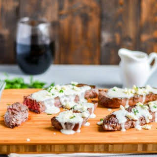 Grilled Sirloin Steaks with Roasted Garlic Gorgonzola Cream Sauce.
