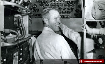 Photo: Wilkinson gets a seat in the cockpit during a team flight. The date of this photo is unknown.