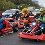 driving in Roppongi in mario karts in Tokyo, Tokyo, Japan