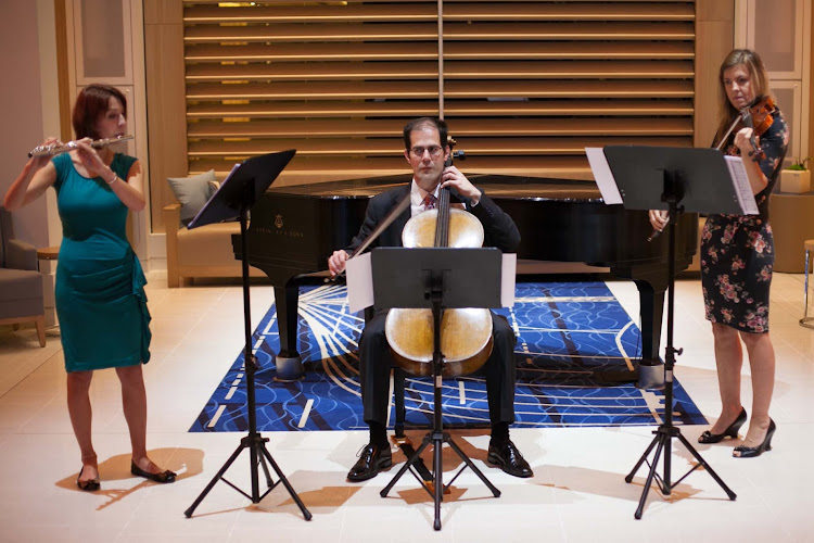 A classical trio performs in the Atrium of Viking Star.