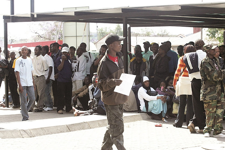 File photo of refugees queuing for asylum permits at Pretoria's home Affairs Department.