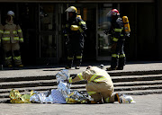 One of the firefighters fell to their death' and two others were found inside the building' which houses the offices of the Gauteng Health and Human Settlements on Sauer Street on September 5 2018