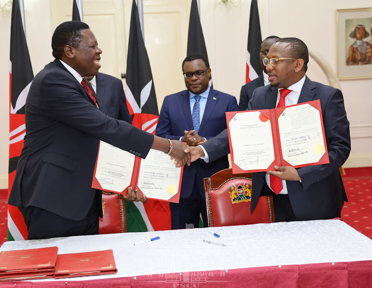 Nairobi Governor Mike Sonko and Devolution CS Eugene Wamalwa after they signed the agreement at State House, Nairobi on February 25, 2020.
