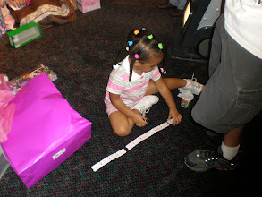 Photo: Kaleya decides to count her tickets