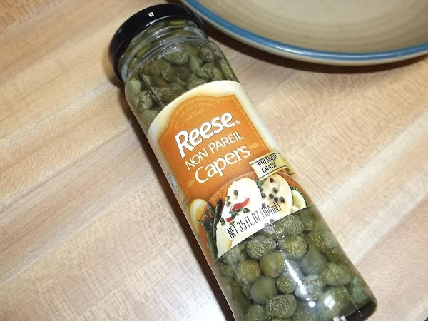 After sauce has simmered the additional 20 minutes after adding olives, add capers; simmer...