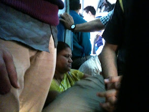 Photo: Travelers sitting on the floor of the train. iPhone picture taken while seated, but squashed between several people!