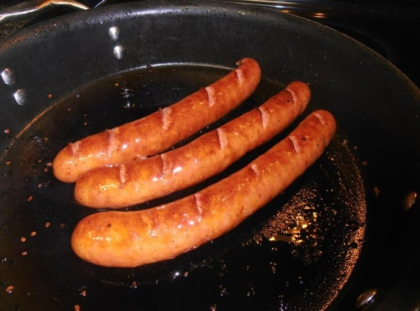 cut slits in sausage.  in the same frying pan, cook sausage until golden...