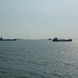 ships lining up to enter Taiwan's largest harbor: Kaohsiung in Kaohsiung, Kao-hsiung city, Taiwan