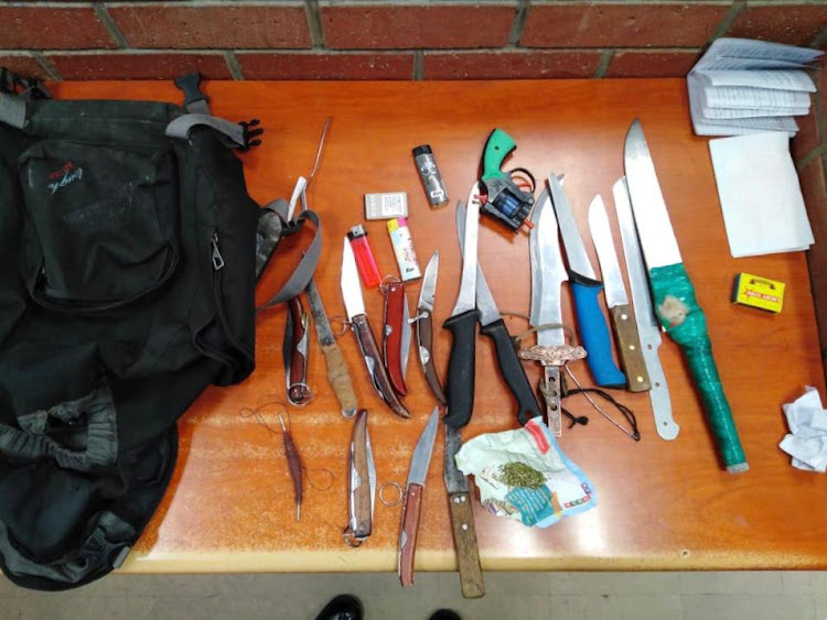 During the search, various dangerous weapons and dagga were confiscated.