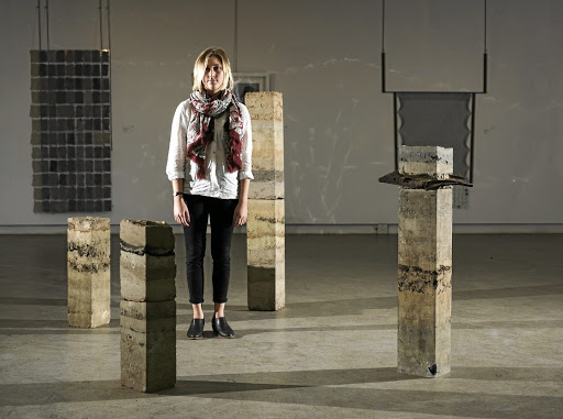 Cut off: Winner Jessica Kapp with her rammed-earth columns and embedded-object installation Mapping Time. Picture: SUPPLIED