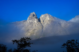 Photo: Early moring light on Kongen and Dronninga - the King and the Queen, in Romsdalen, Norway