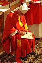 Photo: Bishop Breidenthal signs a Declaration of Intention