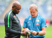 Bafana Bafana coach Stuart Baxter (R) in a discussion with his assistant Molefi Ntseki (L) during the national team's training session at Moses Mabhida Stadium on September 6 2018.