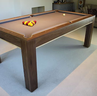 Refined pool table with snooker balls setup for a game
