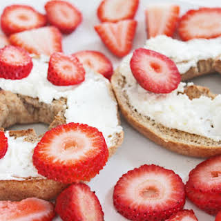 Whole Wheat Bagel with Organic Cream Cheese and Strawberries.