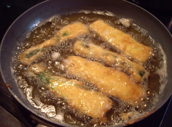 Fry in oil a few minutes on each side until golden brown.