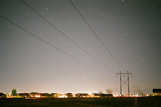 Photo: Housing lights not bad. Comet PANSStars between the homes and the power line.