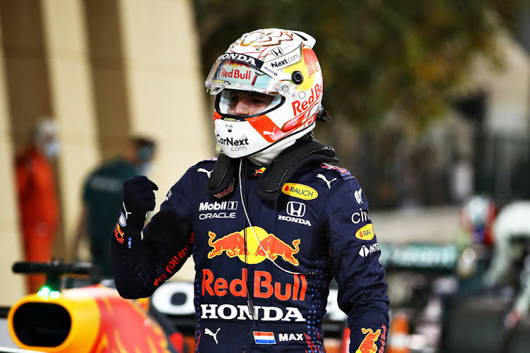 Pole position qualifier Max Verstappen of Netherlands and Red Bull Racing celebrates in parc ferme during qualifying ahead of the F1 Grand Prix of Bahrain at Bahrain International Circuit on March 27, 2021 in Bahrain, Bahrain.