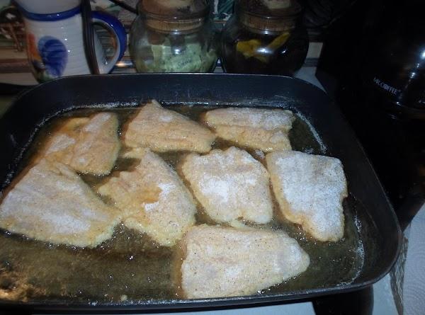 Place fish fillets in hot skillet.