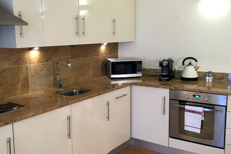 Fully equipped kitchen at Monument Executive
