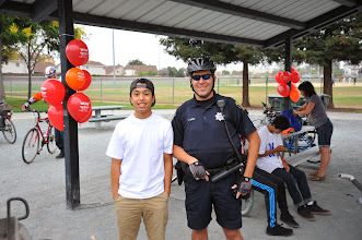 Photo: Officer R. Lopez with a Milpitas High student.