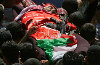 Photo: **  ADDS THAT IT IS MABROUK'S  GUN THAT IS ON HIS BODY  ** Palestinian mourners carry the body of Nasser Mabrouk,38, with his gun on his body, a militant from the Popular Front for the Liberation of Palestine during his funeral in the Al Ain refugee camp of the West Bank city of Nablus, Tuesday, Aug. 21, 2007. Israeli troops shot and killed the Palestinian gunman in an operation in the West Bank city  before dawn Tuesday, the army and Palestinian doctors said. The soldiers operating in the Al Ein refugee camp saw a Palestinian gunman who fired at them before they returned fire and hit him, the army said. (AP Photo/Nasser Ishtayeh)