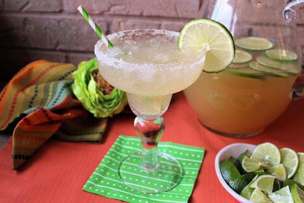 Pour the drink mix into the glass and put a lime wedge in the...
