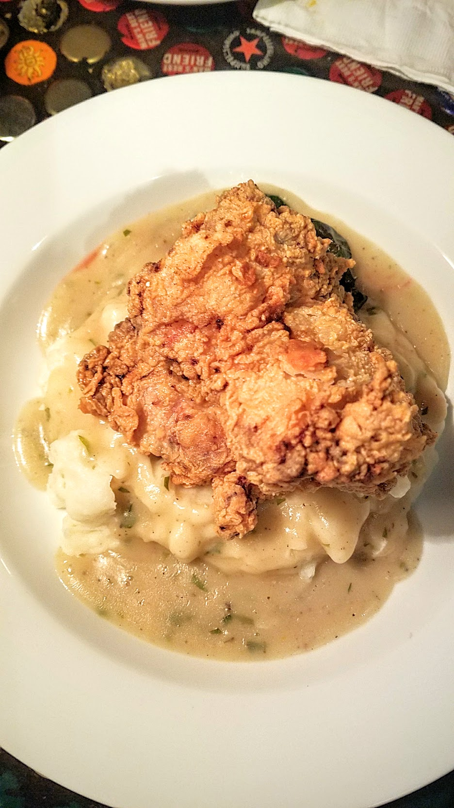 Example Food at Saraveza buttermilk fried chicken with mashed potatoes and braised chard and tarragon gravy