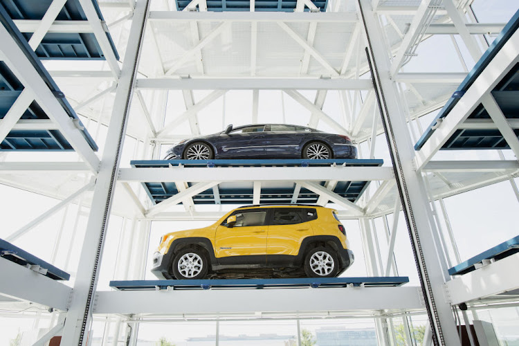 Vehicles sit inside the Carvana Co. car vending machine in Frisco, Texas, U.S.