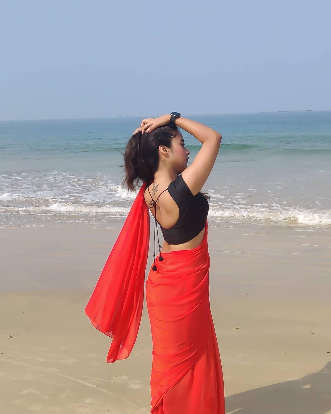 Deepthi Sunaina Red transparent saree black blouse Navel Queens