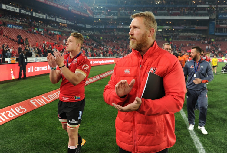 Ruan Ackermann and coach Johan Ackermann of Lions waving to the crowds after loosing during the Super Rugby Final match between Emirates Lions and Crusaders at Emirates Airline Park on August 05, 2017 in Johannesburg, South Africa.