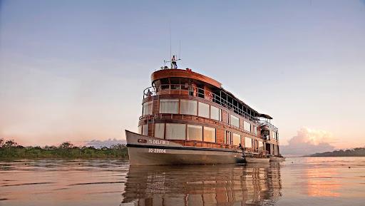 delfin ii.jpg - Delfin II sails down the Amazon River during a Lindblad expedition.