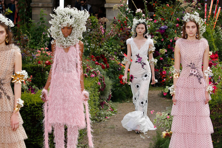 Flower crowns featured heavily in the Rodarte show on July 2, 2017, at Haute Couture Paris Fashion Week in France.