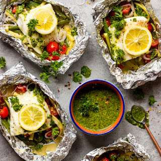 Baked Fish and Vegetables in Foil with Chimichurri Sauce.