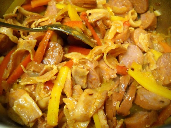 Add sausage, paprika and red pepper flakes. Stir and cook for about 3 minutes.