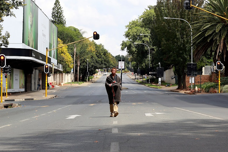 Sifundo Mkhize walking through a deserted Oxford Road in Sandton.