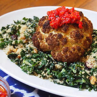 Whole Roasted Cauliflower with Sun-Dried Tomato Pesto and Couscous Kale Salad