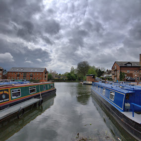 Market Harborough Canal Basin by Michael Topley - Transportation Boats ( clouds, water, uk, england, sky, leicestershire, houseboat, buildings, canal, market harborough )