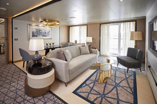 The living room area of a suite on Seven Seas Splendor.