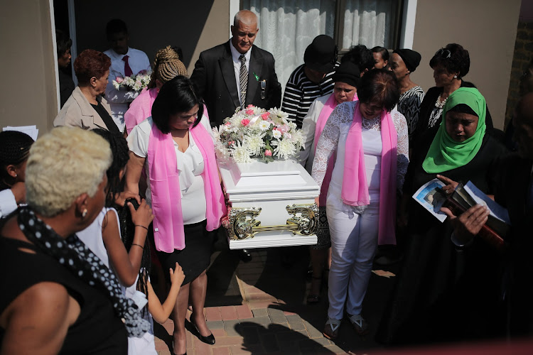 Family members carry Shaynice Talla's coffin. She was found murdered and discarded in a drain near her home in Eldorado Park, Johannesburg.