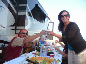 Photo: Don and Lucinda toasting at the crab dinner