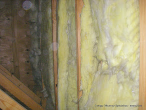Photo: More discoloration - note joist bays open below leading straight into house from garage attic