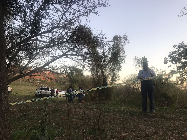 Police cordon off an area of bush in Phoenix, north of Durban, after the body of a child - believed to be that of missing schoolboy Miguel Louw - was discovered on Monday afternoon.
