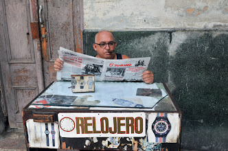 Photo: A watchmaker reads the newspaper in Havana on September 24, 2010. Cuba is to allow some houses to be rented in US dollars for the first time in 50 years as well as the opening up of small businesses as it seeks to shed 500,000 public jobs, state media said Friday. AFP PHOTO/STR (Photo credit should read STR/AFP/Getty Images)