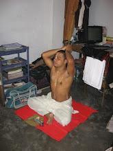 Photo: Sri Bandhu Smaran Brahmachari in Dhaka Mahaprakash Math in his morning rituals