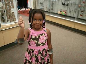Photo: Kaleya finds some Wonder Woman bracelets at Target