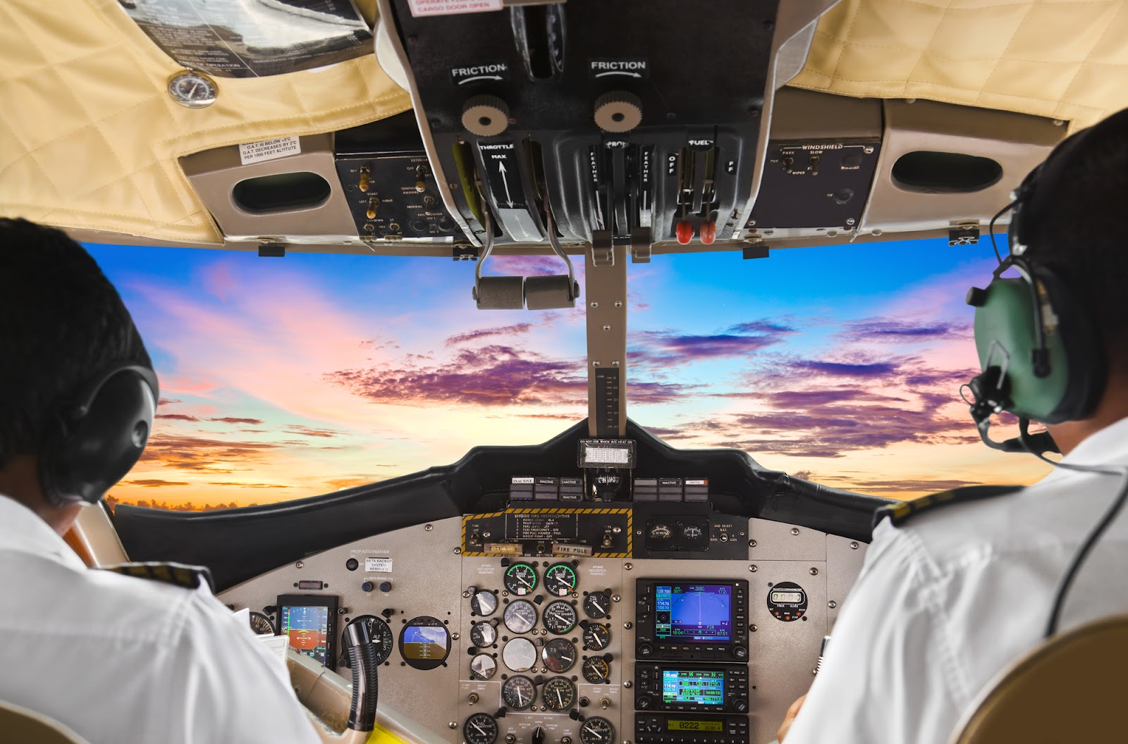 Two pilots in the cockpit while flying