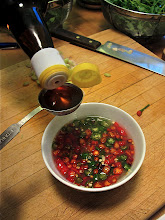Photo: making the chilli sauce for the fish lahb