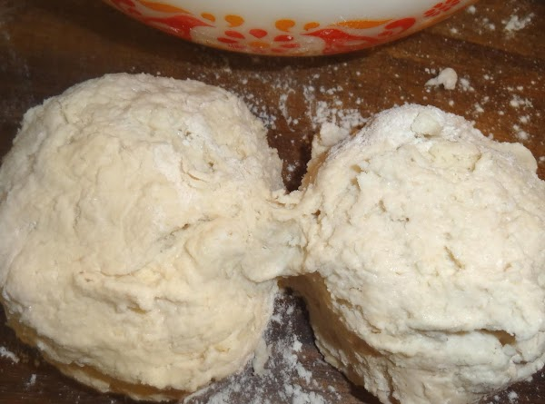 Now form the dough into a round ball, dipping your hands in flour to...